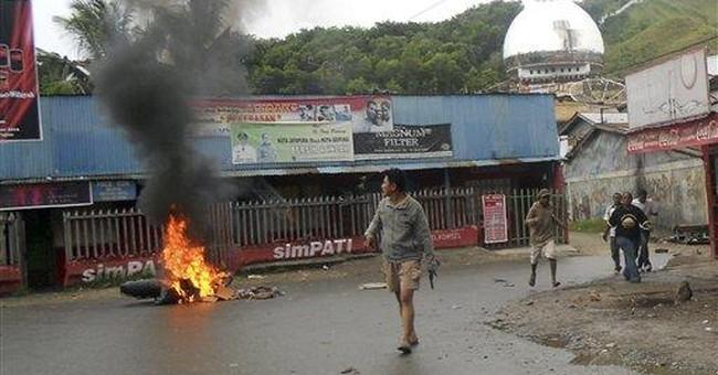 Activist killing sparks riot in Indonesia's Papua