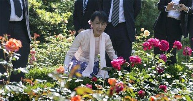 After 21 years, Suu Kyi finally reaches Nobel home