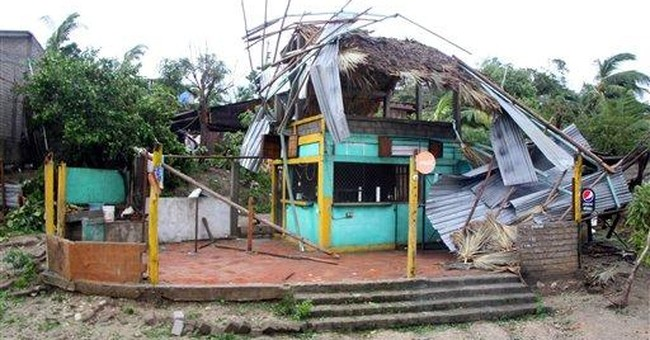 Carlotta kills 2, weakens to tropical depression