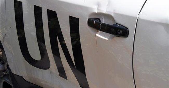 UN observers in Syria suspend patrols