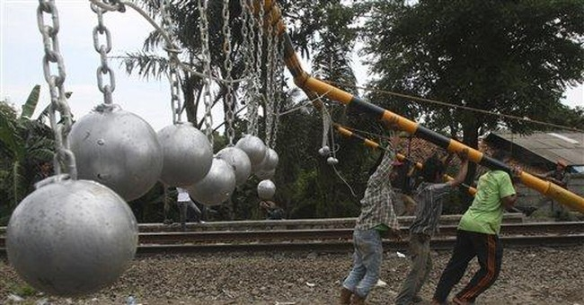 Indonesia tries to deter train 'surfers' _ again