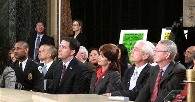 Groups file signatures to recall Wis. Gov. Walker