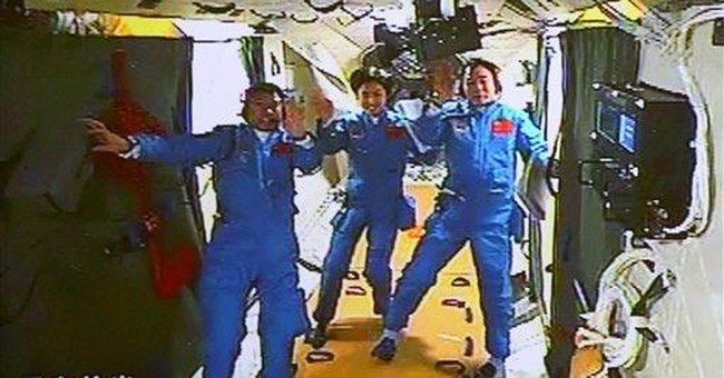 Chinese spacecraft docks with orbiting module