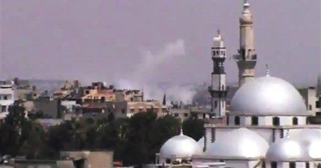 Syrian activists report renewed shelling in Homs