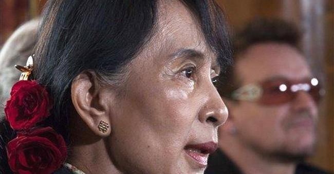 Suu Kyi walks on with 'star-struck' Bono