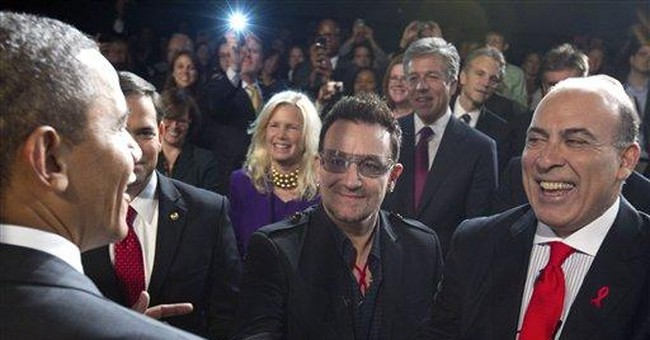 AP PHOTOS: Bono's many brushes with greatness
