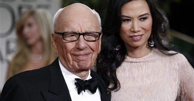 Murdoch to pay Jude Law, 36 others for hacking