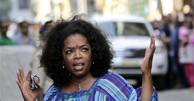 Oprah Winfrey's guards scuffle with Indian media