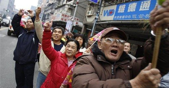 Taiwan president race darkened by spying charges
