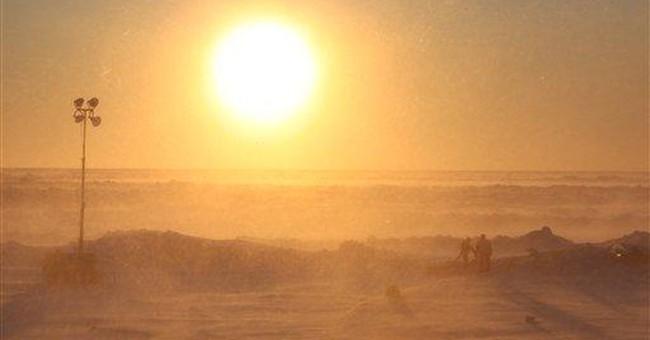 Icebreaker prepares to leave iced-in Alaska town
