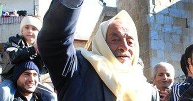 Ambush of police truck in Syria kills 14