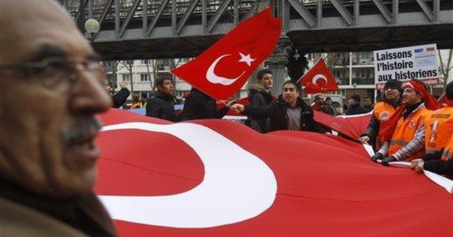 Turks march in Paris to denounce genocide bill