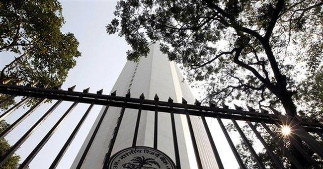 India cuts growth forecast, keeps rates unchanged