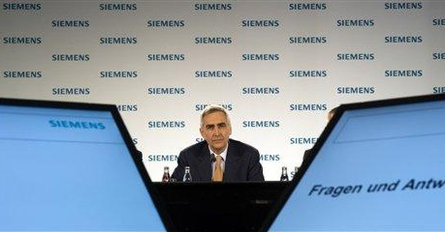 Siemens quarterly net profit falls 17 percent