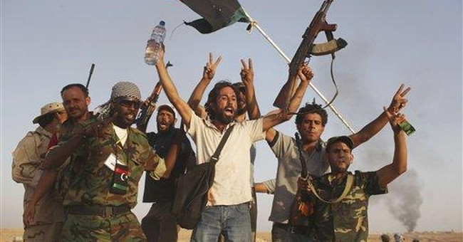 Libyan defense minister seeks deal in seized town