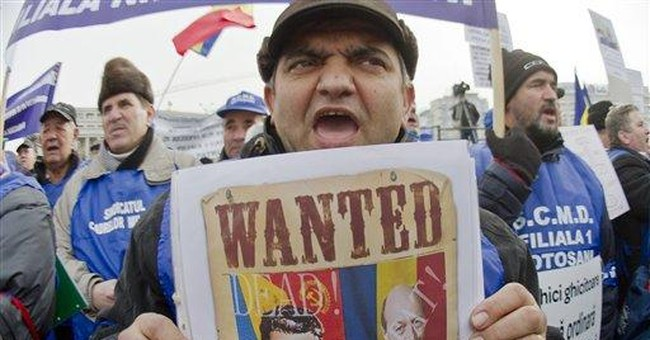 Romanian PM calls for unity as thousands protest