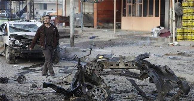 Officials: Car bombs kill 14 across Baghdad