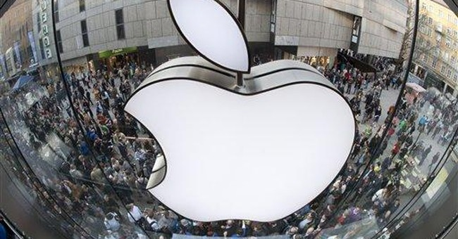 Apple briefly passes Exxon as most valuable co.