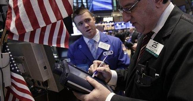 Stocks close higher on Fed promise of low rates