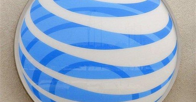 AT&T posts 4Q loss on charges; revenue increases