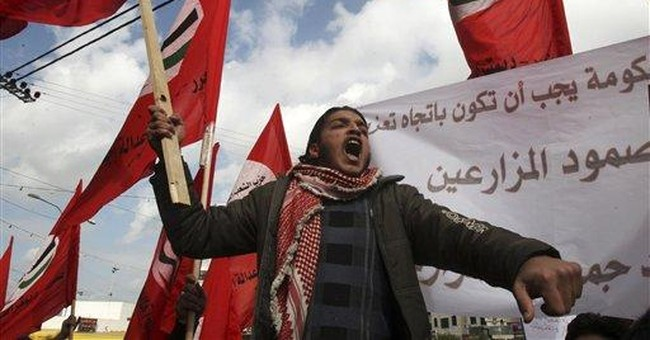 Palestinians protest over tax increase
