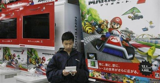 Nintendo posts loss on strong yen, weak sales