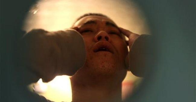 Kyrgyz prisoners sew lips shut; is mafia to blame?