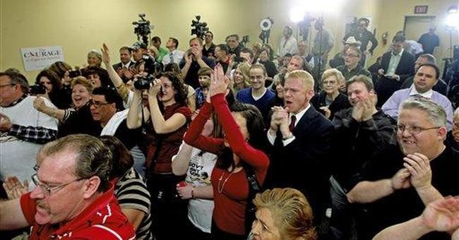 Santorum, Paul campaign out West as Florida votes