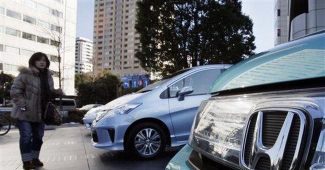 Honda sees sharp drop in profit on Thai floods