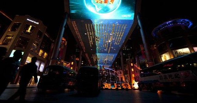 China's state TV expanding, but fetters remain