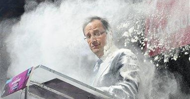 Flour dumped on top French presidential candidate
