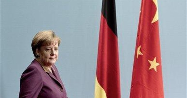 China criticizes Iran sanctions as Merkel visits