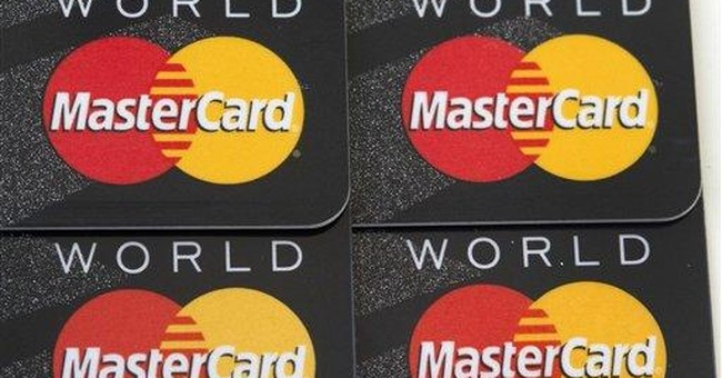MasterCard takes $495M charge to cover fee suit