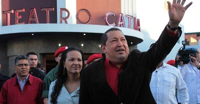 Chavez raps allies for posing kids with rifles