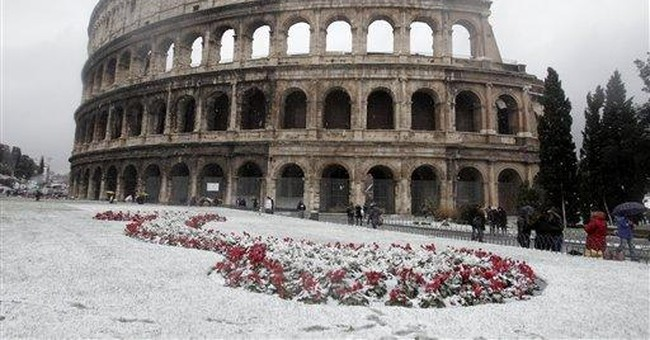 Snow falls in Rome as Italy is hit by cold snap
