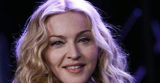 Madonna launching video on billboards, online