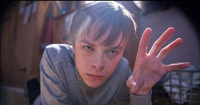 'Chronicle' edges Radcliffe's 'Woman' with $22M