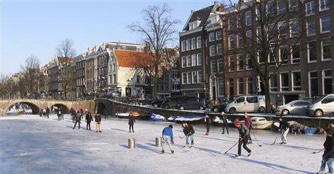 Dutch clean ice to raise chances of skating race