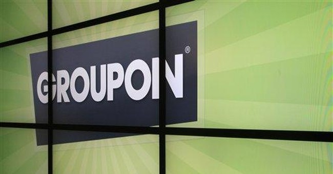 Groupon reports 4Q loss, higher revenue