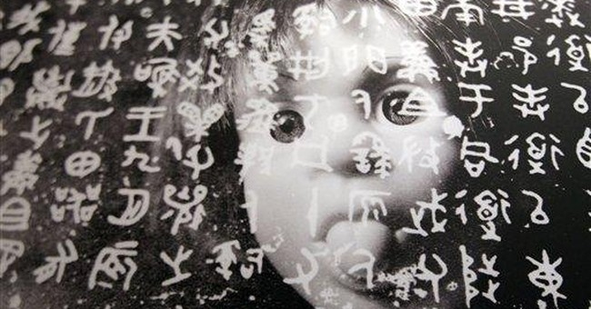 Censored Chinese artist's photos coming to NYC