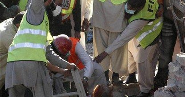 Deaths from factory collapse in Pakistan up to 21