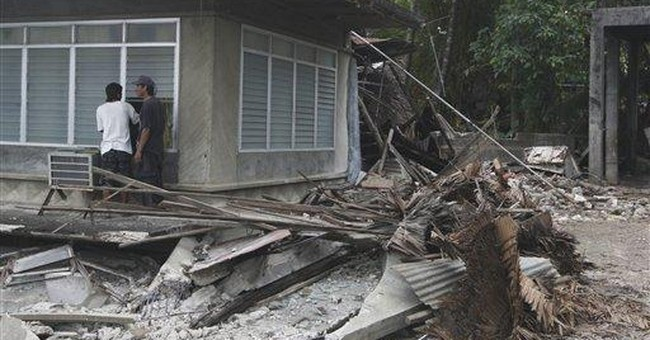 Hopes fade for dozens buried in Philippines quake