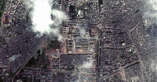 APNewsBreak: Satellite spots tanks in Syrian city