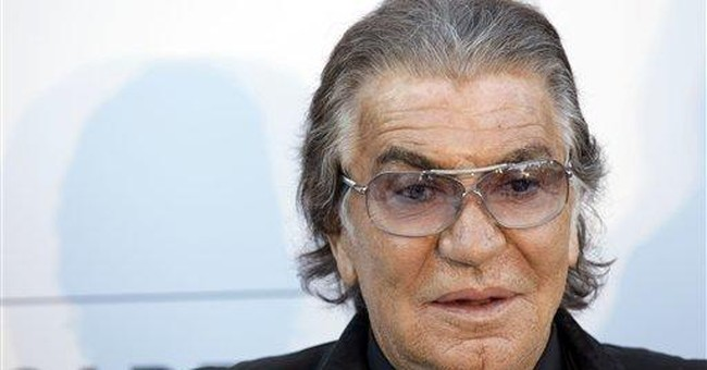 Designer Roberto Cavalli trades pleats for tweets