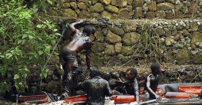 Oil spill fouls river in eastern Venezuela
