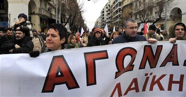 Greek premier defends bailout deal, painful cuts