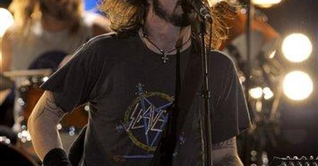 Triumph, tragedy dominate Grammy Awards
