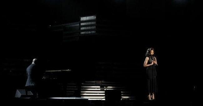 Grammys honor Houston, celebrate 'fallen sister'