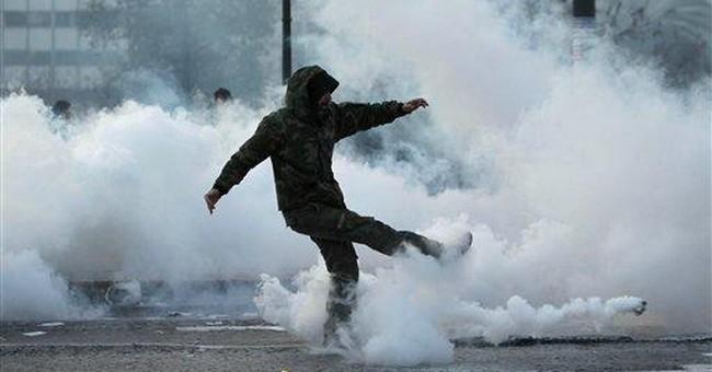 Rioting engulfs Athens, buildings burn before vote