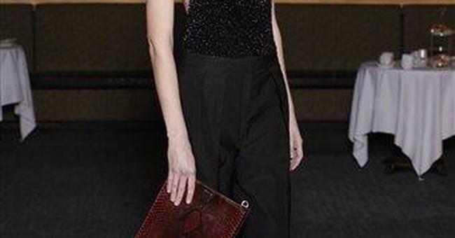 In refocusing clothing line, Olsens shun spotlight